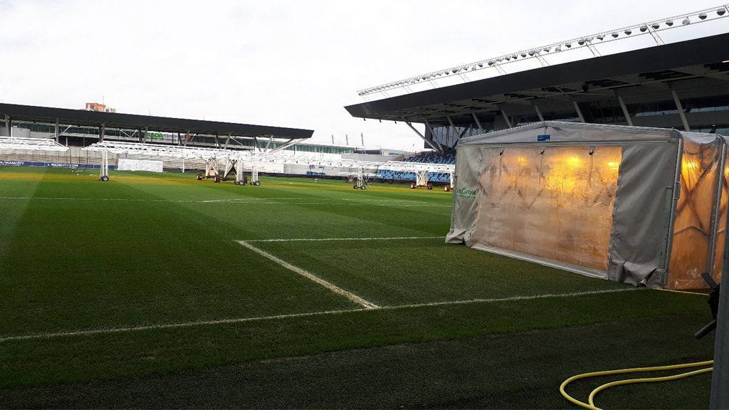 Lighting rigs on sports turf pitch