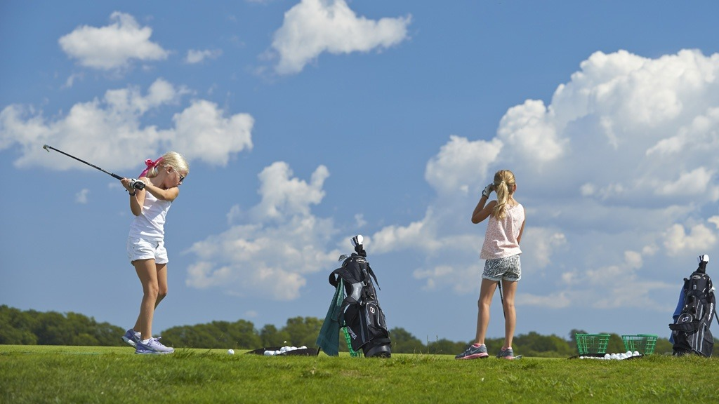 Young girl golfers playing