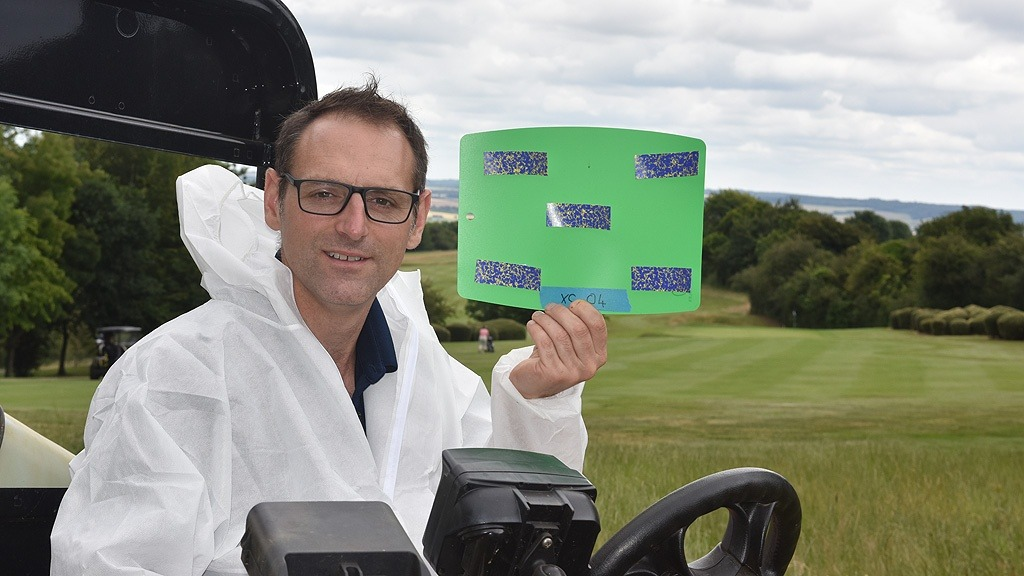 Glenn Kirby with water sensitive paper test of nozzle spray pattern